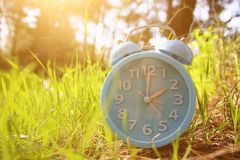 Image of spring Time Change. Summer back concept. Vintage alarm Clock outdoors. Image of spring Time Change. Summer back concept. Vintage alarm Clock outdoors Royalty Free Stock Photography