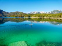 Image of stand up paddling on a beautiful mountain lake in autumn royalty free stock image
