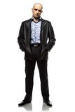 Image of standing hairless man in leather jacket Stock Photo
