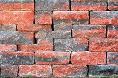 An image of a stone wall in the garden Stock Photo