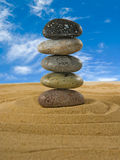 Image of stones in the sand against the sky close-up Stock Images