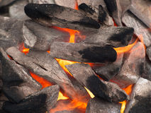 Image of stones with soot   tongues of fire. On the background Royalty Free Stock Images