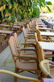 Image of street cafe with wicker chairs Stock Images