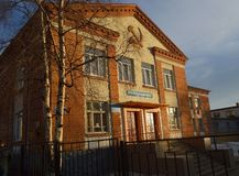 School building,where during the war years the was a hospital  in the city of Kandalaksha.April 2019 year.aPRIL 2019 . Image of street in city of Kandalaksha stock images
