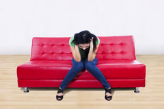 An image of stress female on sofa at home Stock Image