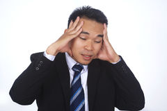 Image of stressed asian businessman. Having problems and headache at work Royalty Free Stock Photography
