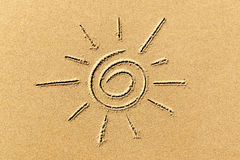 Image of the sun on the sand beach coastline close-up Stock Image