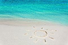 Image of a sun in the sand on the tropical beach Stock Images