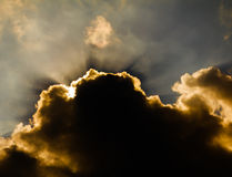 Sun shine through rain cloud Stock Photography