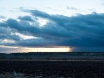Image of the sunrays on dark sky Stock Photography