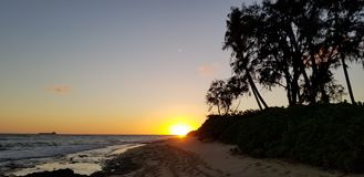 Sunset at the beach in Ohau Hawaii royalty free stock photo
