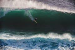 Image Surfer on Blue Ocean Big Mavericks Wave in California. Image of Surfer on Blue Ocean Big Mavericks Wave in California, USA. Surfer riding in tube. Gun Royalty Free Stock Image