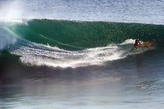 Image Surfer on Blue Ocean Big Mavericks Wave in California Royalty Free Stock Images