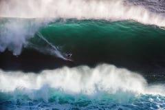 Image Surfer on Blue Ocean Big Mavericks Wave in California. Image of Surfer on Blue Ocean Big Mavericks Wave in California, USA. Surfer riding in tube. Gun Stock Image