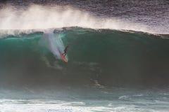 Image Surfer on Blue Ocean Big Mavericks Wave in California. Image of Surfer on Blue Ocean Big Mavericks Wave in California, USA. Surfer riding in tube. Gun Royalty Free Stock Images