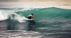 Surfer on Blue Ocean Wave, Bali, Indonesia. Riding in tube. Stock Photos