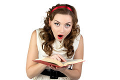 Image of surprised pinup woman reading book Royalty Free Stock Photo