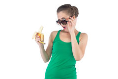 Image surprised woman with banana and sunglasses Stock Photos
