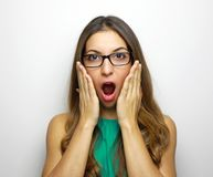 Image of surprised woman wearing glasses and dressed in green dr stock photography