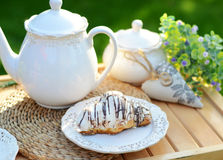 Image of a sweet breakfast in the garden. Image of a sweet breakfast in the summer garden Stock Images