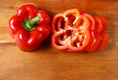 Image of sweet red pepper sliced on hardboard Royalty Free Stock Photo