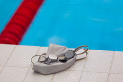 Image of swimming pool, goggles and hat. Nobody Royalty Free Stock Images
