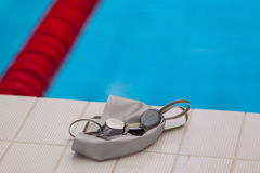 Image of swimming pool, goggles and hat. Nobody Stock Image