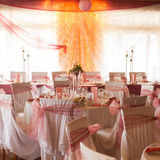 An image of tables setting at a luxury wedding hall Stock Photography