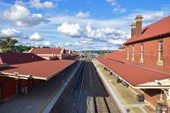 Goulburn train railway station with waiting area and rail track stock photo