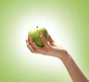 Image of a tasty apple held in a human hand Stock Photography