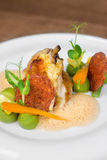 Image of tasty chicken with vegetables in dish in restaurant. Close image of chicken and salami Stock Photography