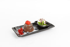 Image of tasty chocolate fondant with ice cream and fruits royalty free stock photos