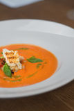Image of tasty pumpkin soup with crouton and basil served in res Stock Photos