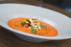 Image of tasty pumpkin soup with crouton and basil served in res Stock Images
