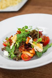 Image of tasty salad in dish in restaurant. Close image of vegetarian salad Stock Photography