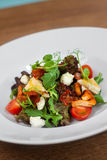 Image of tasty salad in dish in restaurant. Close image of vegetarian salad Royalty Free Stock Images