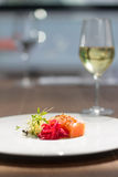 Image of tasty salmon on dish with white vine. Close image of salmon on dish in restaurant Stock Photography