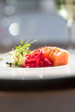 Image of tasty salmon on dish with white vine Stock Photo