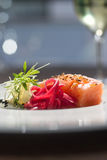 Image of tasty salmon on dish with white vine Stock Image