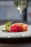 Image of tasty salmon on dish with white vine. Close image of salmon on dish in restaurant Royalty Free Stock Photos