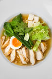 Image of tasty soup with chicken and egg in dish. Close image of italian food Stock Images