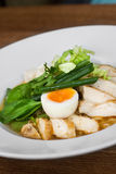 Image of tasty soup with chicken and egg in dish. Close image of italian food Stock Photos