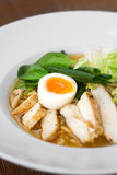 Image of tasty soup with chicken and egg in dish. Close image of italian food Royalty Free Stock Photo