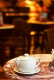 Image of teapot on a table in cafe Stock Photo