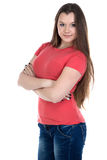 Image of teenage girl with arms crossed. On white background Royalty Free Stock Photography