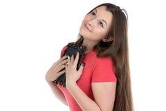 Image of teenage girl holding photo frame. On white background Royalty Free Stock Image