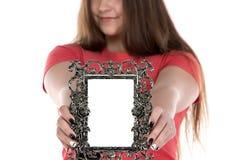 Image of teenage girl showing photo frame. On white background Stock Photos
