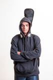 Image of teenager in black clothes and hoodie with headphones is Royalty Free Stock Images