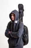 Image of teenager in black clothes and hoodie with headphones is Stock Images