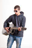 Image of teenager in black clothes, hoodie and sunglasses who is Stock Image